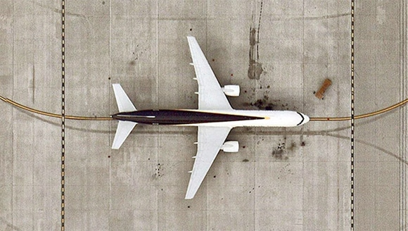 An aerial view of a passenger jet on a tarmac.