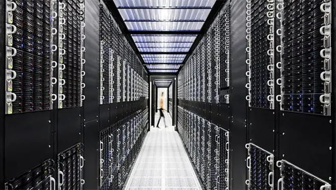 person walking in a server room