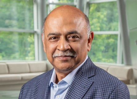Arvind Krishna sits in the IBM headquarters board room