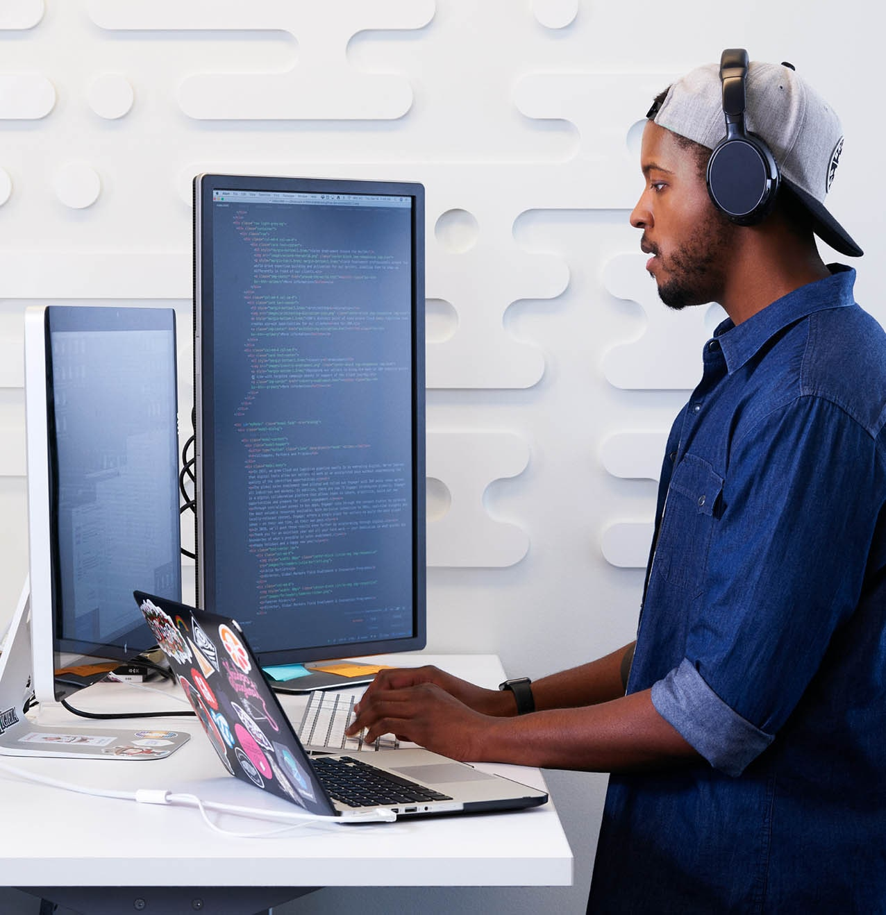 man standing at computer