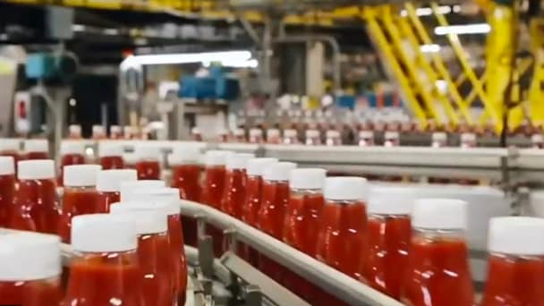 Ketchup bottles in a production line