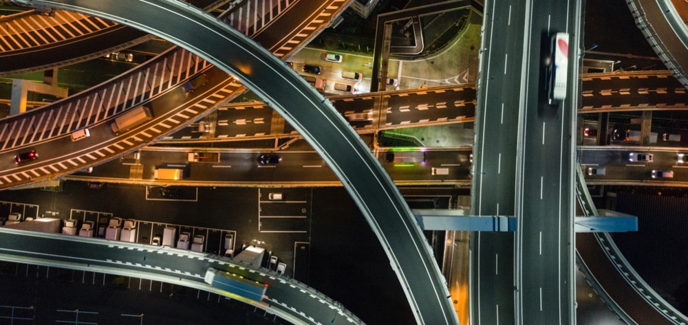 overhead of highway and cars at night