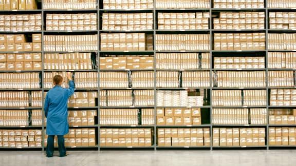 person examining storage shelves