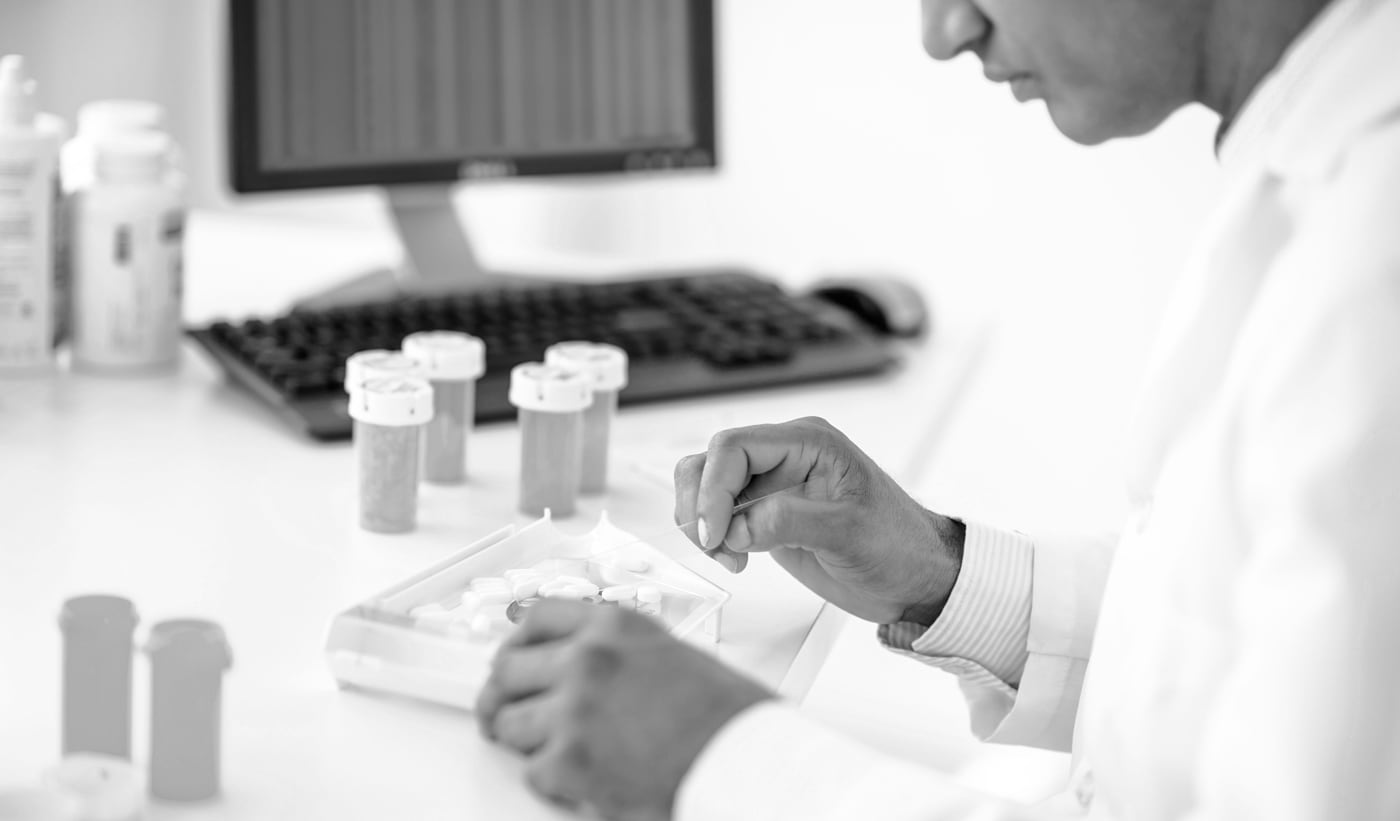 Pharmacist putting medications in a pill sorter