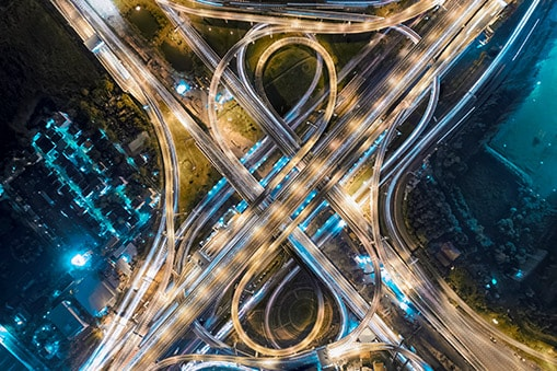 aerial view of illuminated network of highways at night