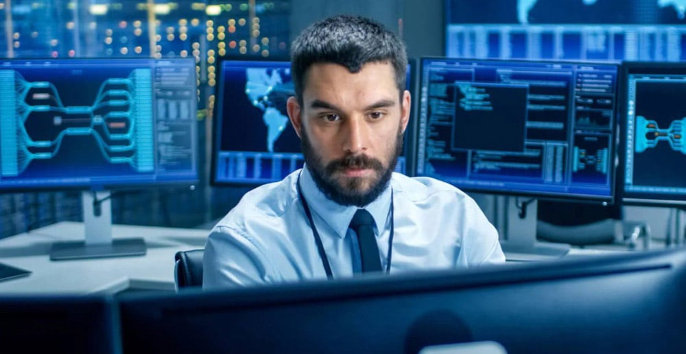 A man at a cybersecurity room