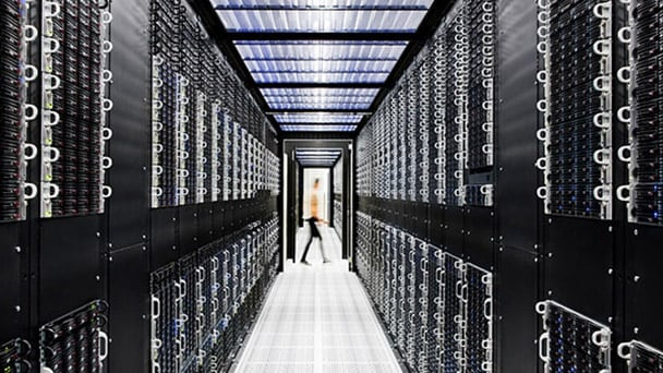 rear shot of person walking in data center