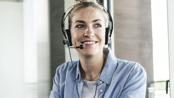 woman with headphones smiling