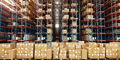 Warehouse with rows of stacked boxes