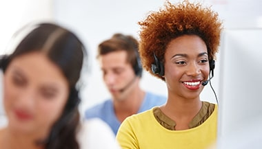three people working in a callcenter