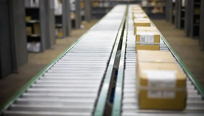 Boxes on conveyor belt in factory