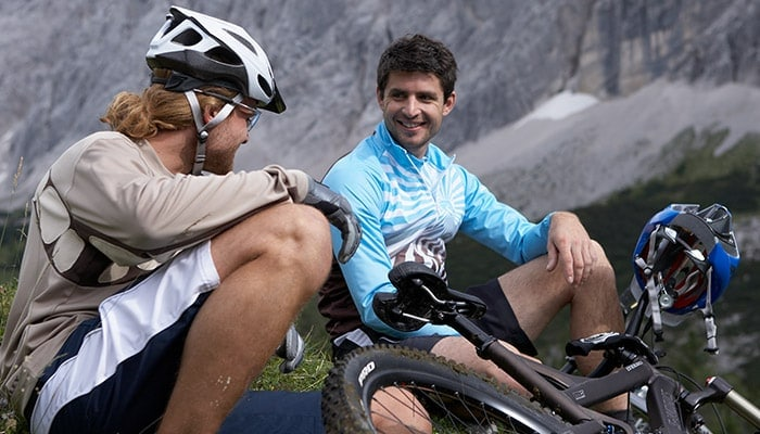Two men taking a break from riding their bicycles