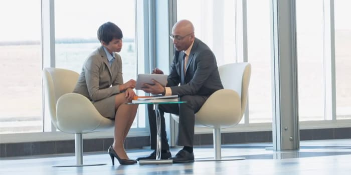 Two executives looking at a tablet