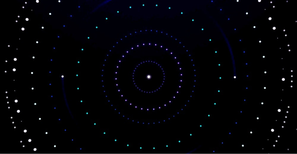 White dots in circle with a black background