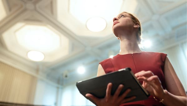 Woman looking up with her tablet