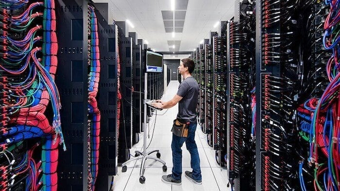 Man working inside a server room