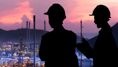 Two workers at oil production facility