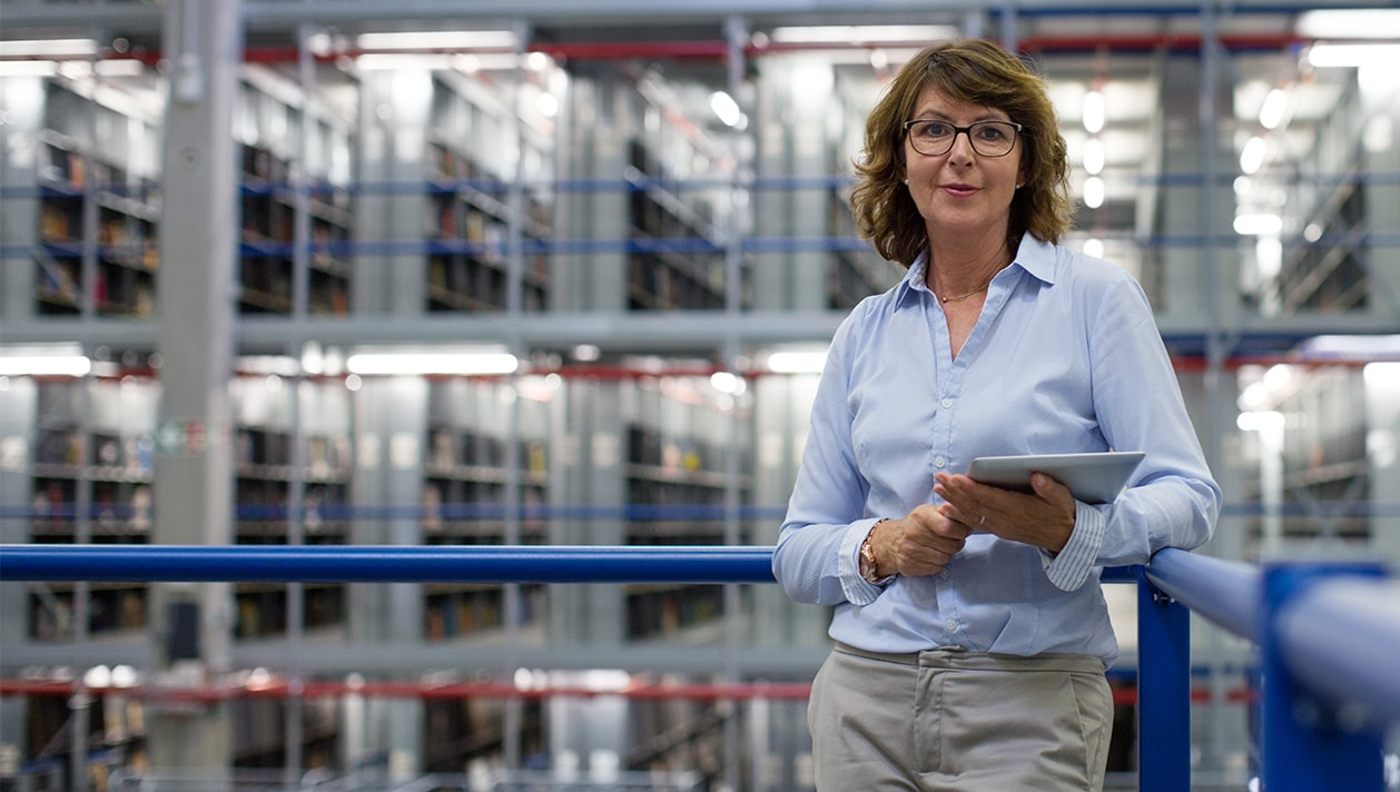 woman using a tablet device in a warehouse