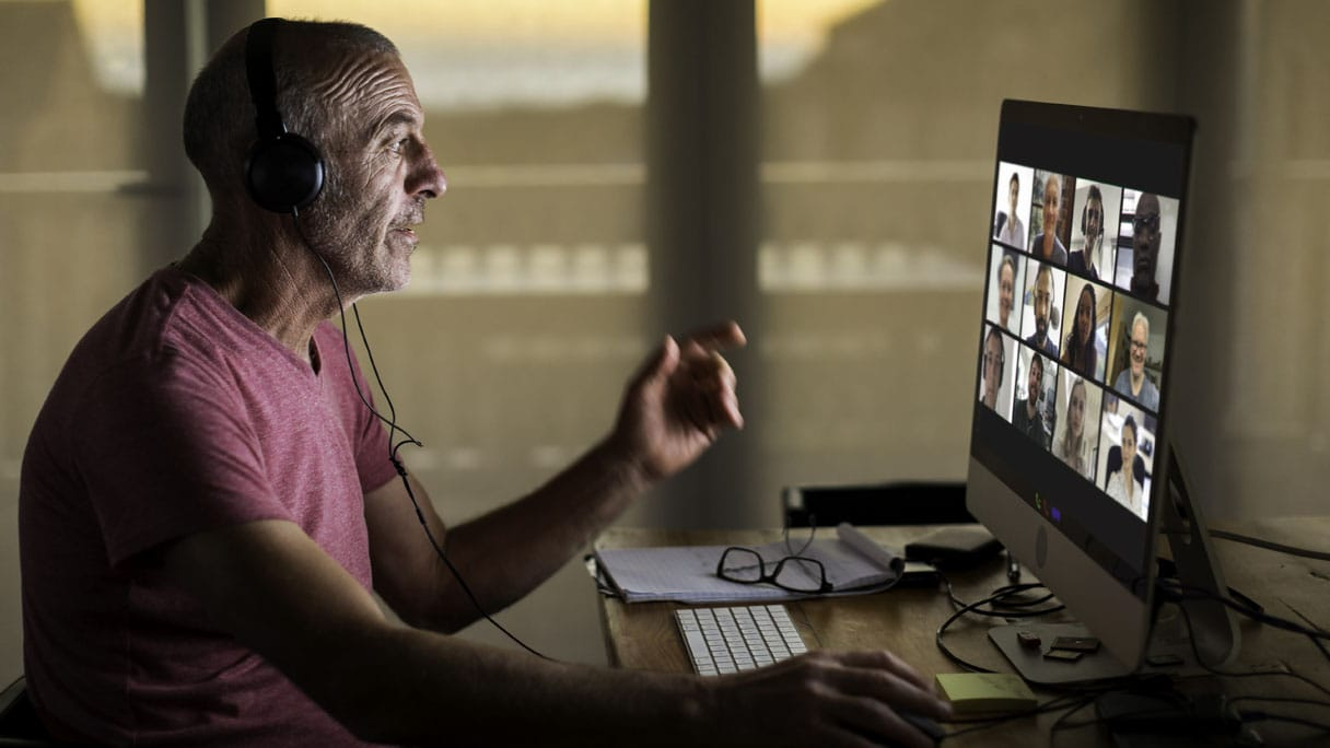 Man participating in online video meeting