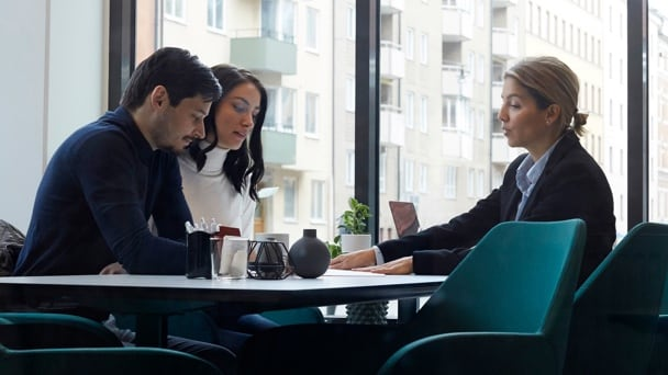 Three people at office meeting