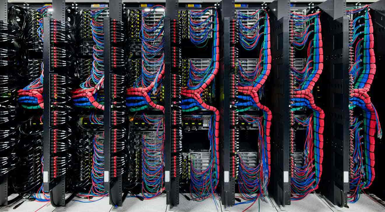 Several racks of servers, shown from the back