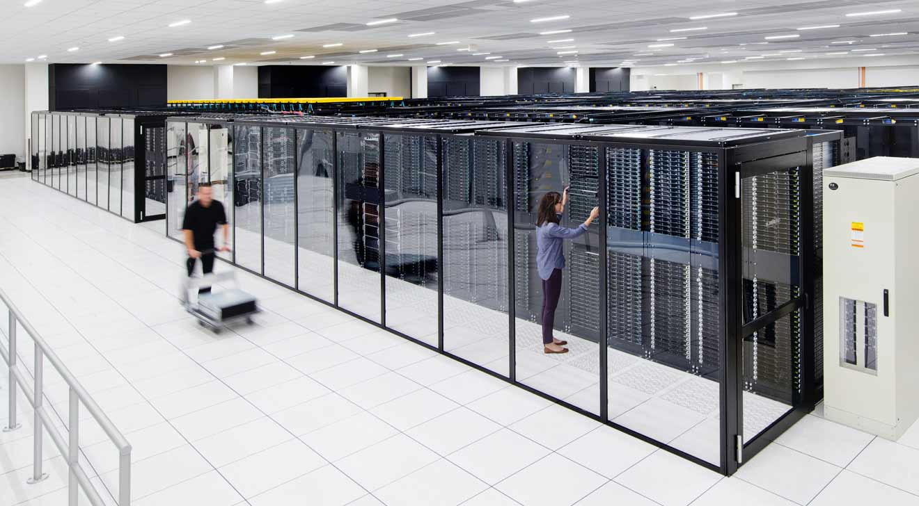 Workers moving storage volumes out of a server room