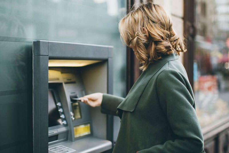 Woman using cash machine