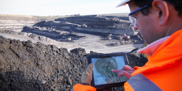 A man capturing the minining spot in a iPad