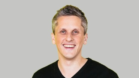Aaron Levie in front of off-white background