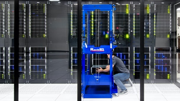 Man working on a rack in a data center