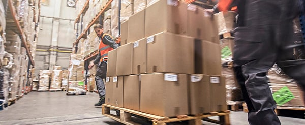 Boxes being moved in a distribution center