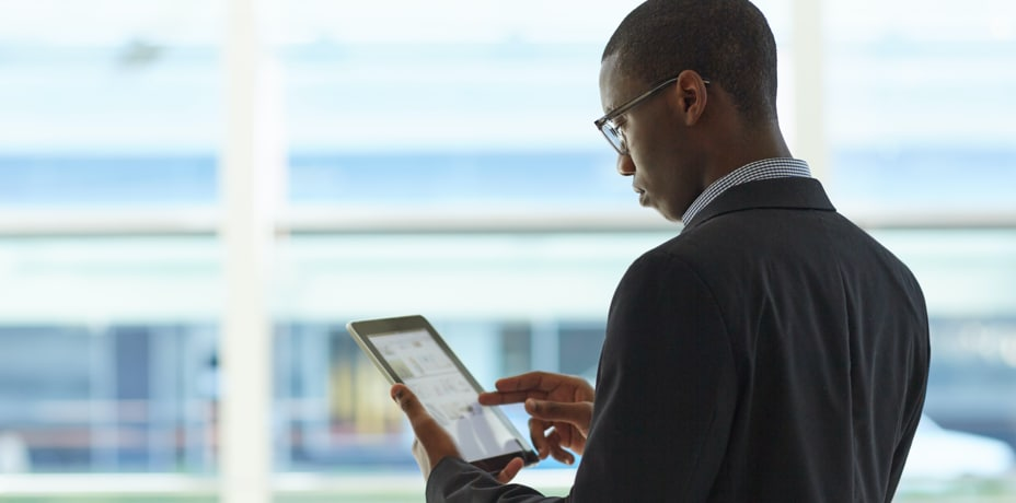 Man in suit using his tablet
