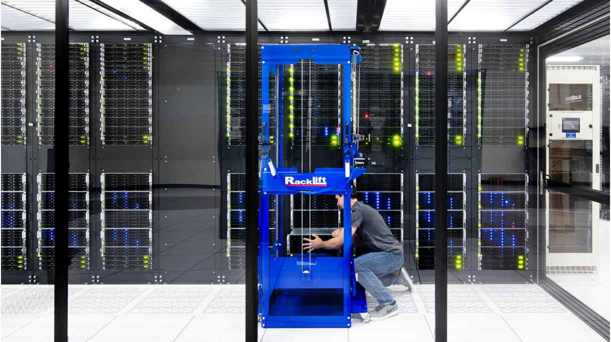 Person working on data server racks