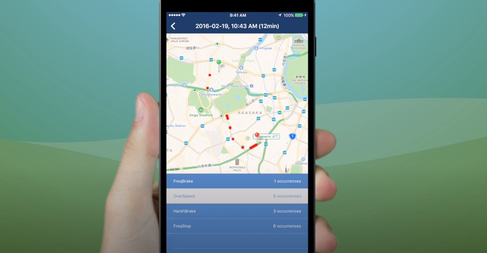 Hand holding mobile device showing roadmap and travel information
