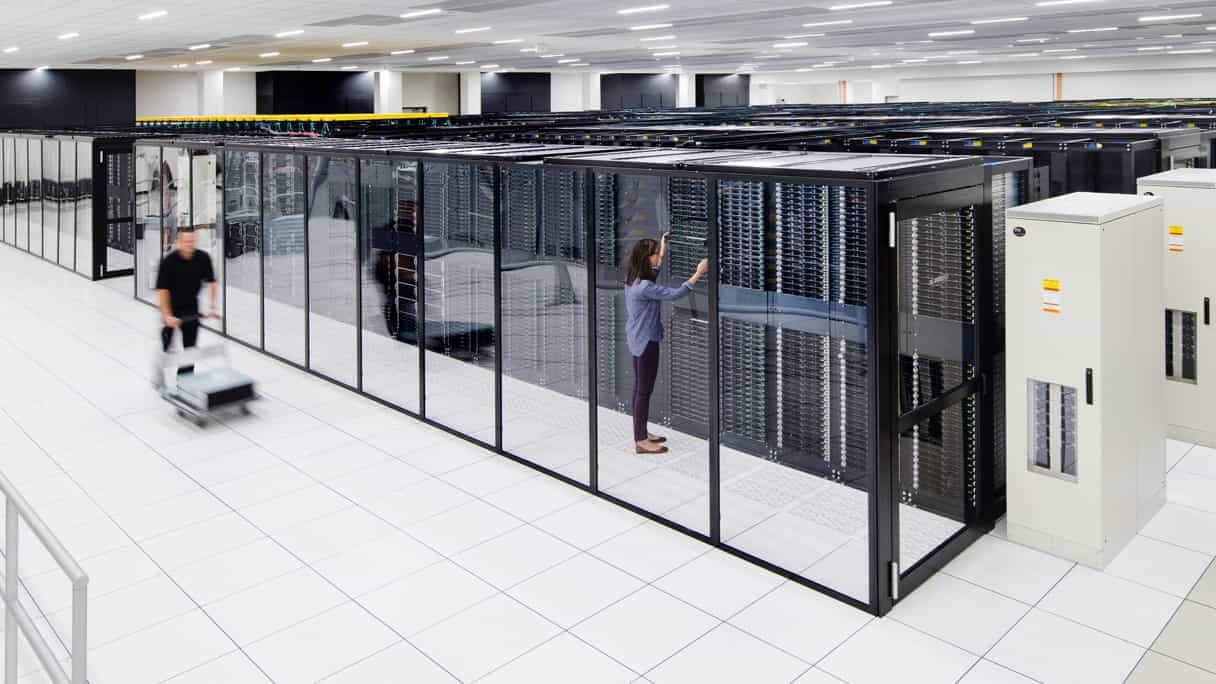 Two people working in data center