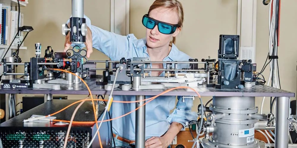 Woman  in the lab wearing blue glasses