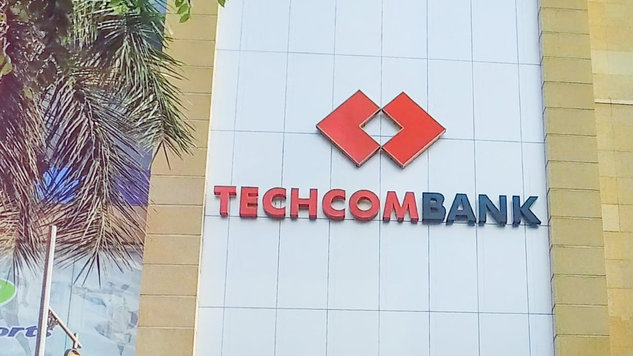 The front of a Techcombank building, prominently showing the company logo