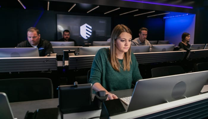 woman at computer in an IBM X-Force Operations center