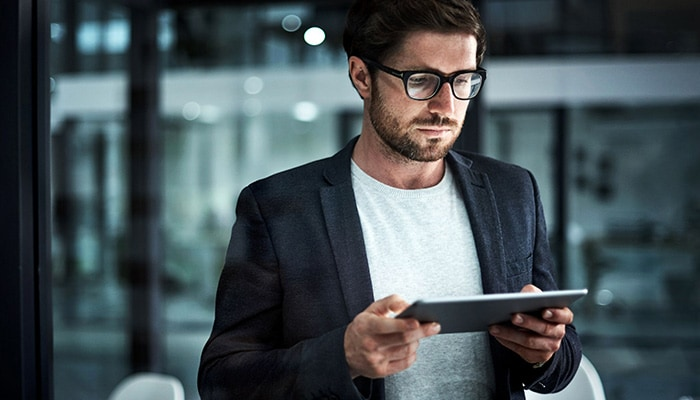 Man looking at iPad in office