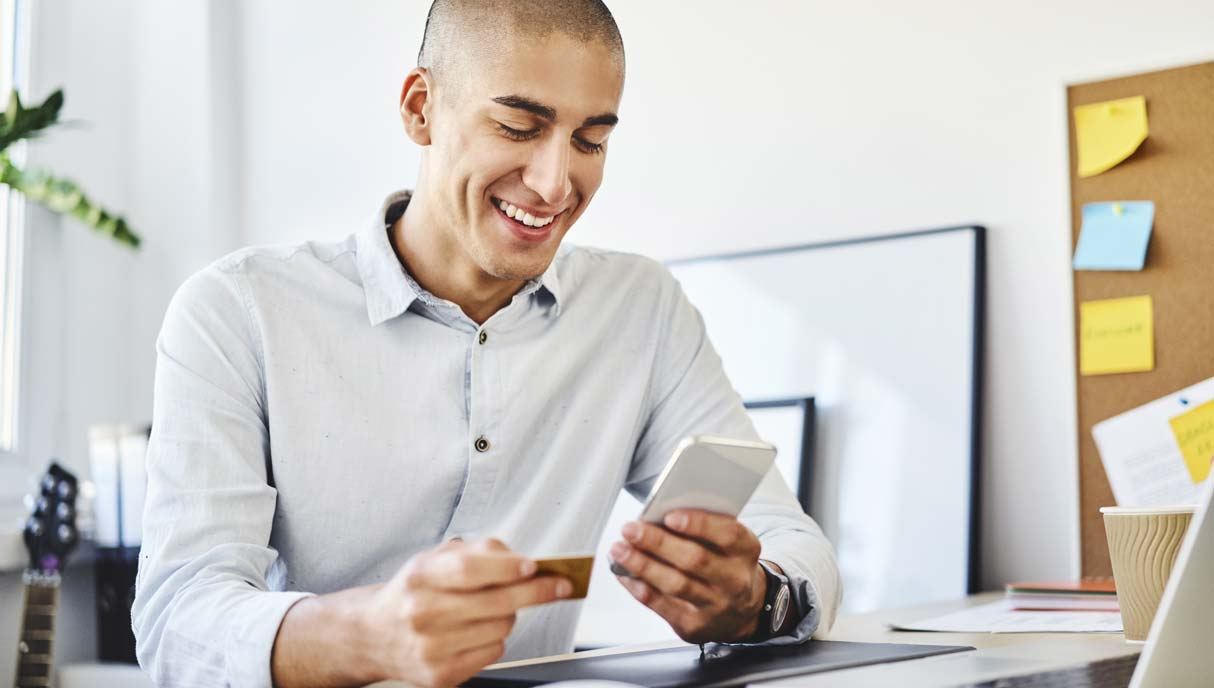 Man using mobile device for online transactions