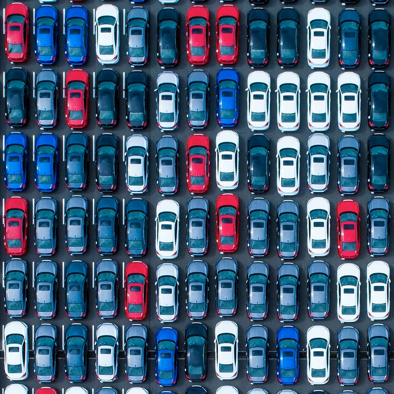 aerial shot of cars in a parking lot