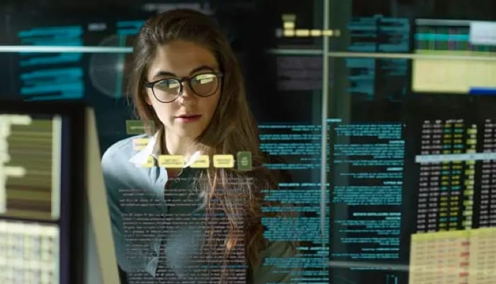 woman working with a several terminal codes, combining incident response with threat intelligence