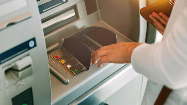 Person using ATM machine