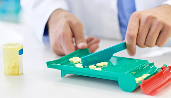 Pharmacist counting out pills