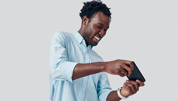 person playing a computer game on a mobile phone