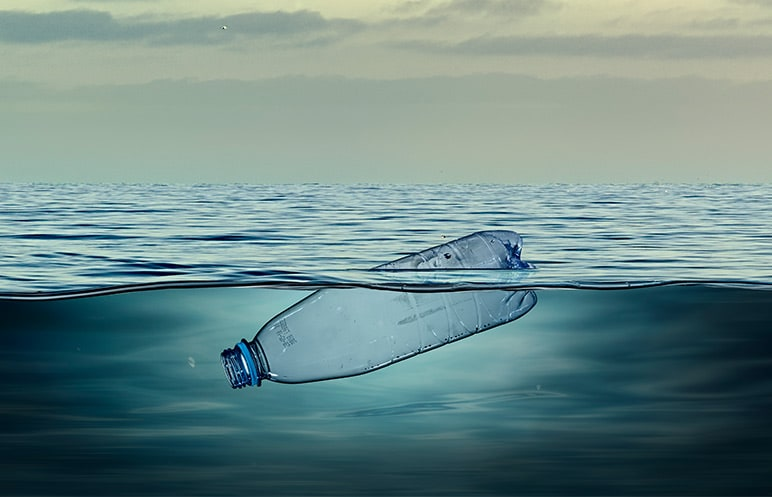 Empty plastic bottle floating in the ocean
