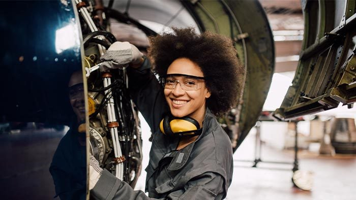 Woman engineer working on aircraft maintenance