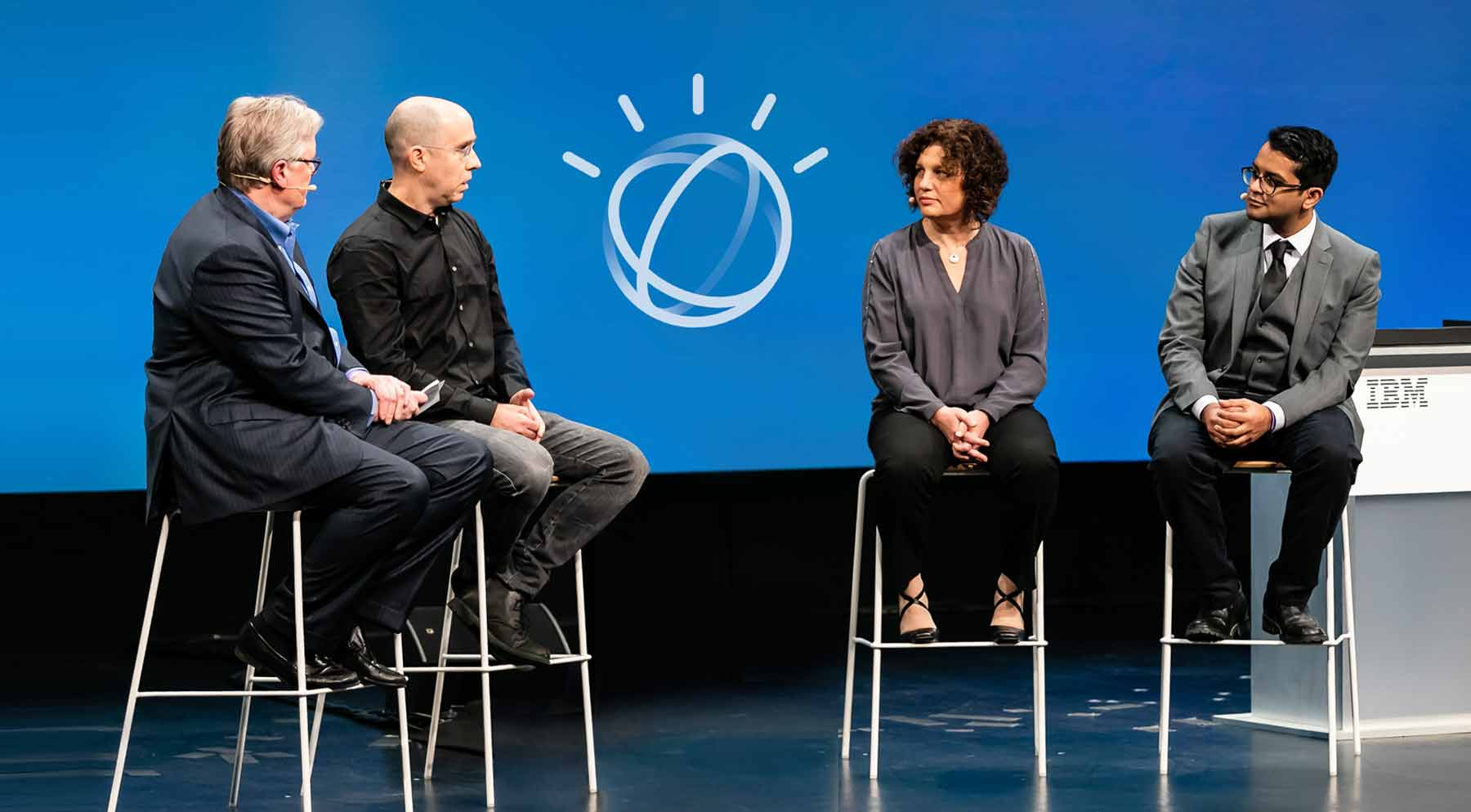Four presenters on stage with Watson logo