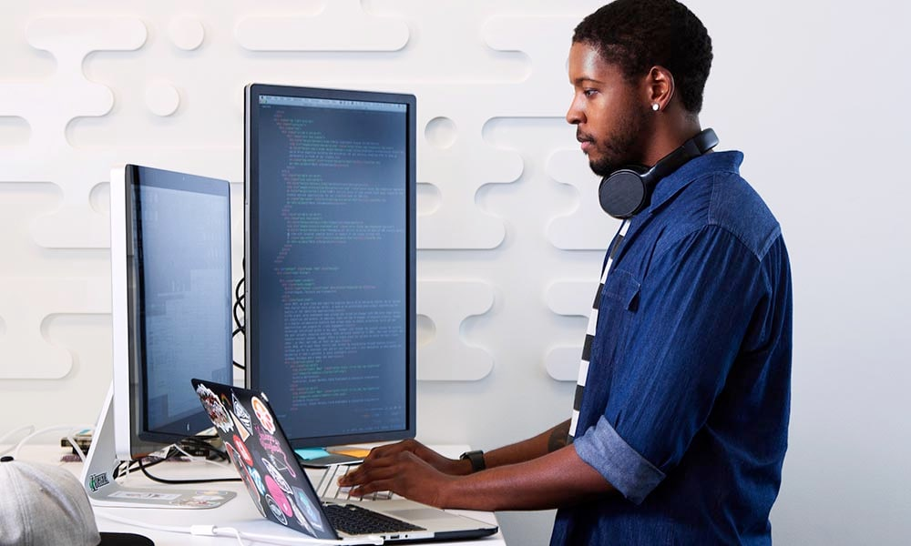 person working with multiple monitors