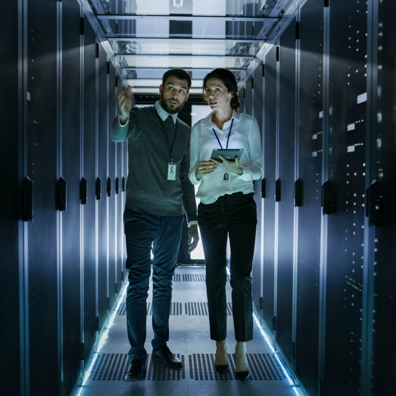 Man and woman in cloud server room